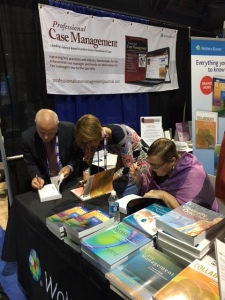 Signing our hearts out at the CMSA Annual Conference.